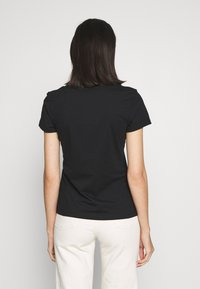 Calvin Klein Jeans - EMBROIDERY V NECK - T-shirts - black - 2