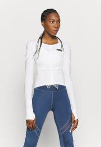 Puma - PAMELA REIF X PUMA COLLECTION RUSHING - Sports shirt - star white - 0