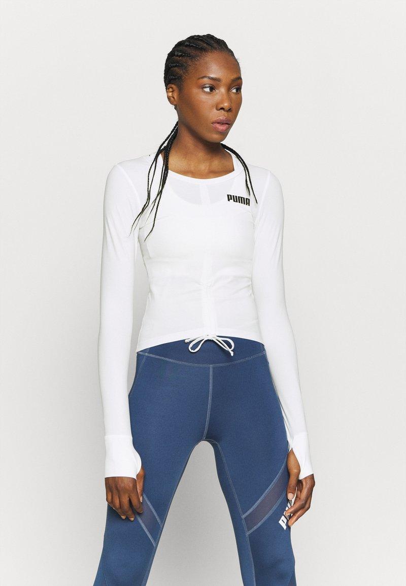 Puma - PAMELA REIF X PUMA COLLECTION RUSHING - Sports shirt - star white