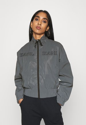 RETRO REFLECTIVE TRACKJACKET  - Lehká bunda - black
