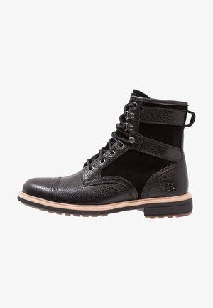 MAGNUSSON - Lace-up ankle boots - black