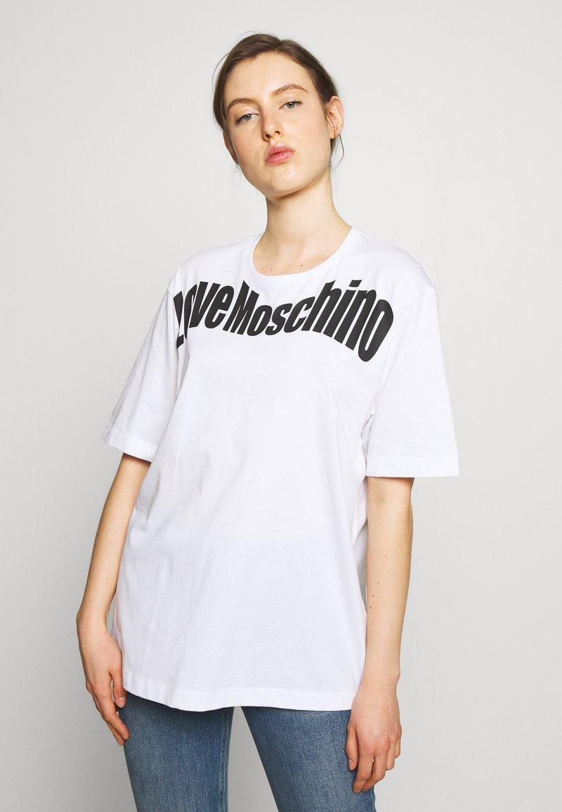 Love Moschino - T-shirt imprimé - optical white