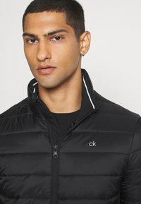 Calvin Klein - LIGHT WEIGHT SIDE LOGO JACKET - Kurtka przejściowa - black - 3