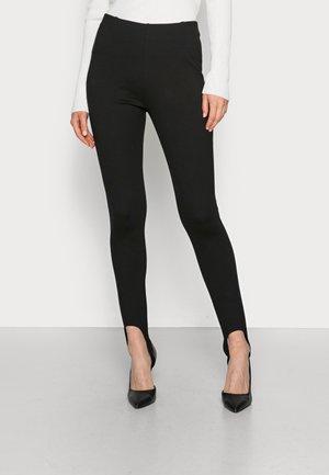SKIPANTS - Leggings - Trousers - black