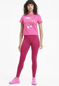 Puma - EVIDE - Leggings - Trousers - glowing pink - 1