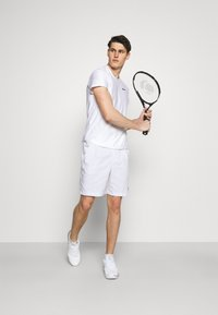 Nike Performance - SHORT HERITAGE - Sportovní kraťasy - white - 1