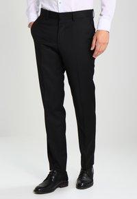Tommy Hilfiger Tailored - RHAMES - Oblekové kalhoty - black - 0