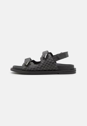 SOJO - Sandaalit nilkkaremmillä - black