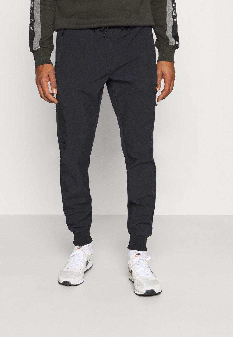 Ellesse - CABOTONE - Pantalones deportivos - black