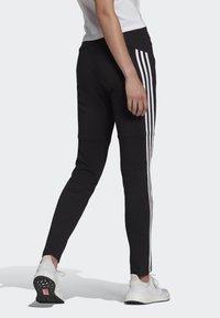 adidas Performance - ADIDAS SPORTSWEAR 3-STRIPES SKINNY PANTS - Pantalon de survêtement - black/white - 1