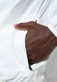 K-Way - CLAUDE 3.0 UNISEX  - Summer jacket - white - 5
