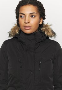 Superdry - EVEREST SNOW - Ski jacket - black