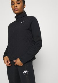 Nike Performance - AEROLAYER - Sports jacket - black/reflective silver - 4