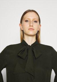 Bruuns Bazaar - PRALENZA ALLEA SHIRT DRESS - Day dress - green night - 5