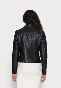 Noisy May Petite - NMREBEL - Faux leather jacket - black - 2