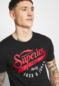 Jack & Jones - JJELOGO TEE - T-shirt imprimé - black - 3