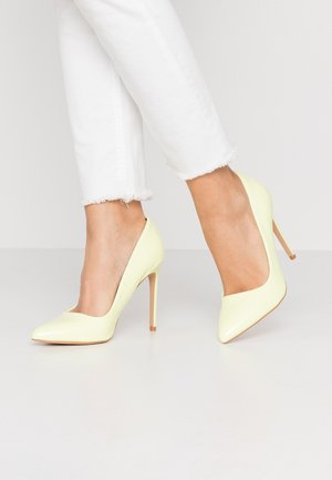 Højhælede pumps - neon yellow