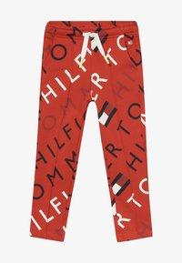 Tommy Hilfiger - SPORTS PRINTED LOGO  - Teplákové kalhoty - red - 2
