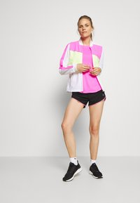 Puma - LITE WARM UP JACKET - Sports jacket - puma white/luminous pink/fizzy yellow