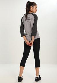 ODLO - BREEZE - 3/4 sportovní kalhoty - black - 2