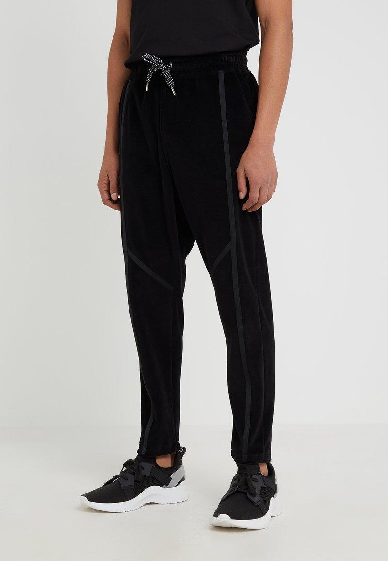 Just Cavalli - PANTS - Tracksuit bottoms - black