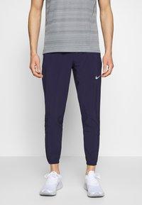 Nike Performance - ESSENTIAL PANT - Verryttelyhousut - imperial purple/reflective silver - 0