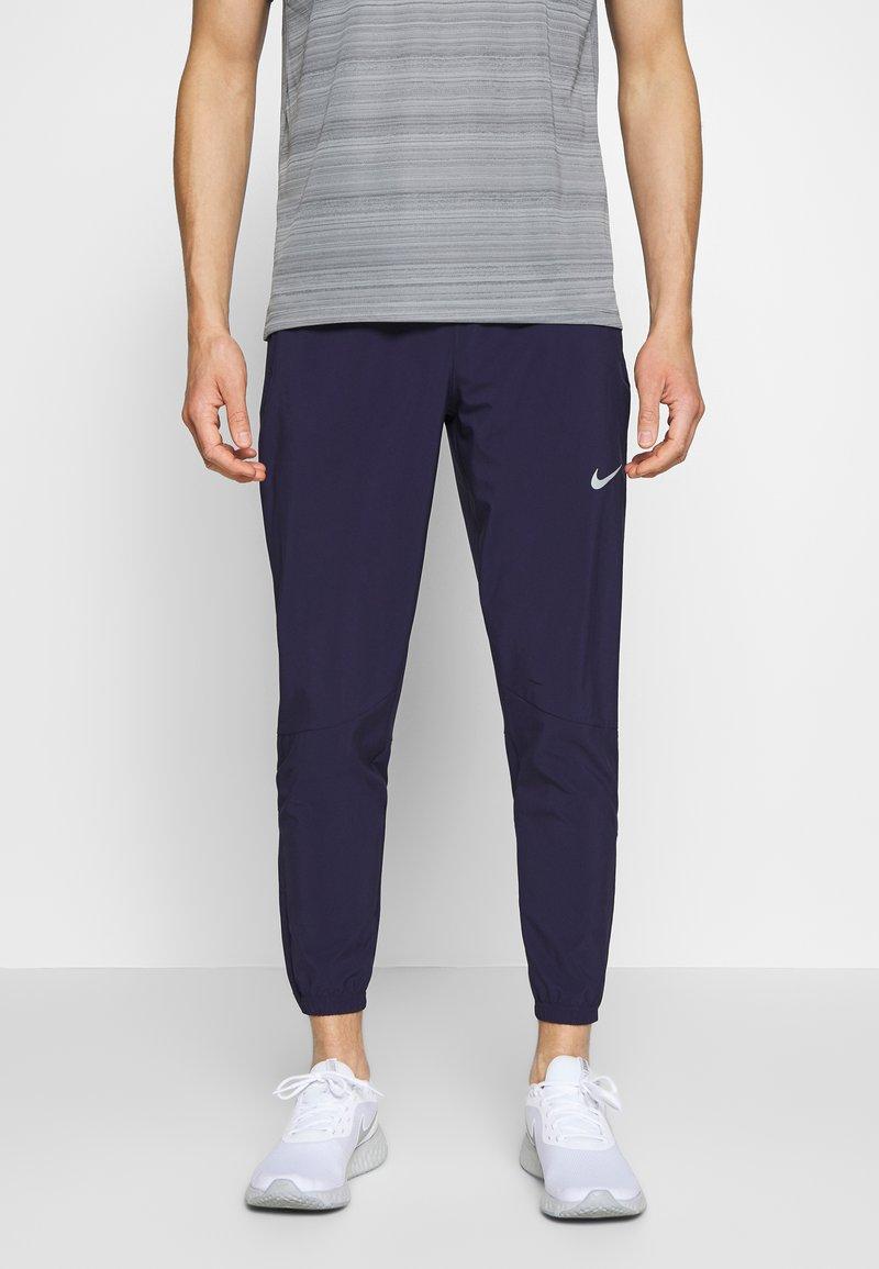Nike Performance - ESSENTIAL PANT - Verryttelyhousut - imperial purple/reflective silver