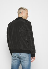 Common Kollectiv - JACKET UNISEX  - Bomber Jacket - black - 2