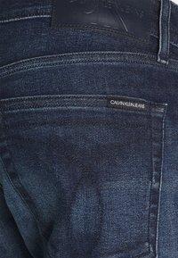 Calvin Klein Jeans - SLIM - Slim fit jeans - denim dark - 5