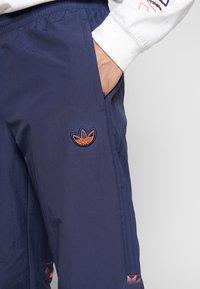 adidas Originals - FOOTBALL GRAPHIC TRACK PANTS - Tracksuit bottoms - blue - 5