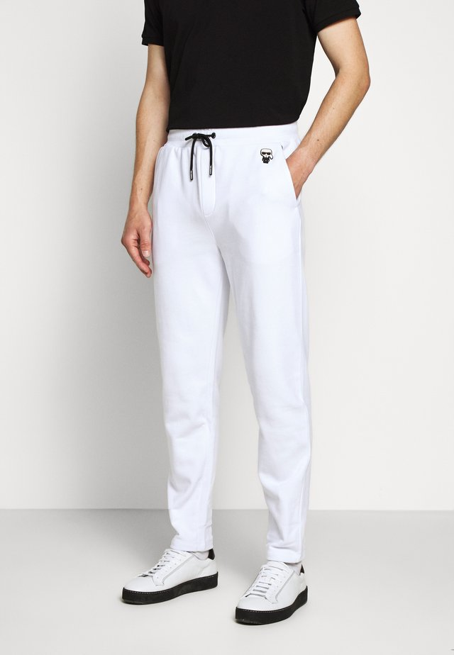 PANTS - Tracksuit bottoms - white