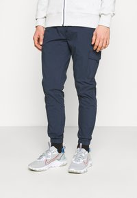 Tommy Jeans - SCANTON - Cargo trousers - blue - 0