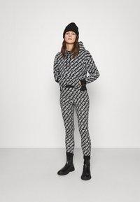 Calvin Klein Jeans - MILANO LOGO  - Leggings - Trousers - institutional black - 1
