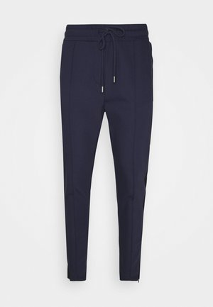 EASTON - Tracksuit bottoms - navy