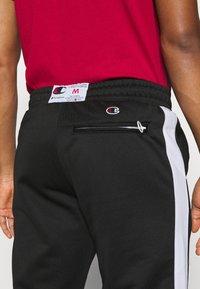 Champion - STRAIGHT PANTS - Tracksuit bottoms - black - 5