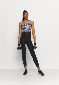 Nike Performance - ICONCLASH BRA - Medium support sports bra - black/purple chalk/white - 1