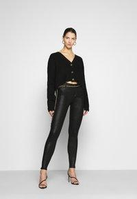 Vila - VICOMMIT  - Trousers - black/glitter - 1