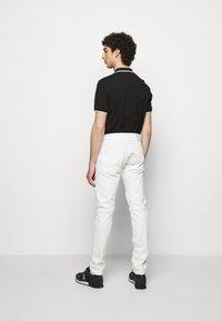 True Religion - ROCCO COMFORT - Slim fit jeans - white - 2