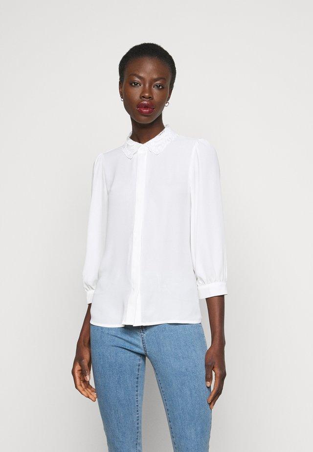 VMDORTHE - Button-down blouse - snow white