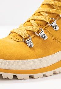 Tamaris - Lace-up ankle boots - saffron - 2