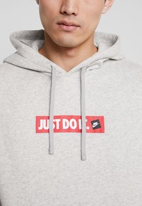 Nike Sportswear - FLC BSTR - Hoodie - grey heather - 4