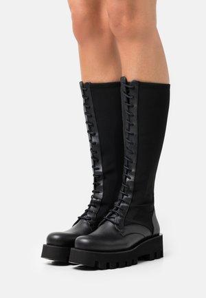 AGNETA - Šněrovací vysoké boty - black omega