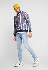 Diesel - D-BAZER - Slim fit jeans - 0095v01 - 1