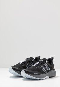 New Balance - NITREL V4 - Trail running shoes - black - 2