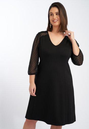 MET TRANSPARANTE MOUWE - Day dress - black