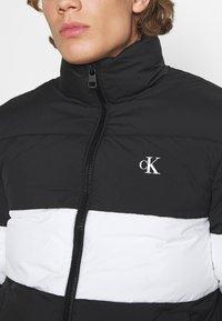 Calvin Klein Jeans - OUTLINE LOGO JACKET - Winter jacket - black - 5