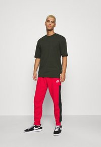 Nike Sportswear - AIR - Tracksuit bottoms - university red/black/white - 1