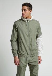 Hummel - SULLIVAN - Waterproof jacket - vetiver - 0