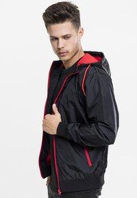 Urban Classics - Light jacket - black/red - 2
