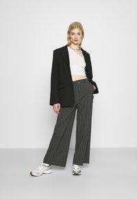 Weekday - LUXA SKEW TROUSERS - Trousers - grey - 1